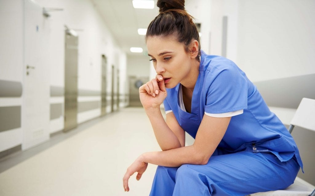 Female doctor stressed